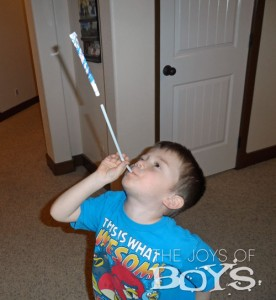 How to make an easy paper rocket using paper, glue, tape and a straw.