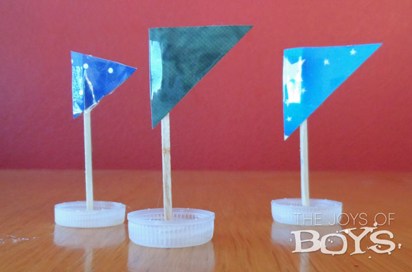 foil river and bottle cap boats